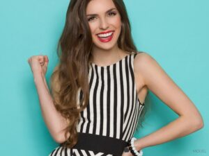 Smiling Brunette Wearing a Black and White Striped Dress