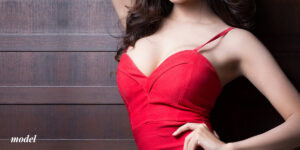 Female Large Breasts in Red Fitted Dress